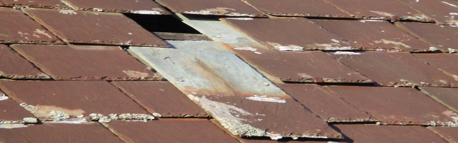 Damaged slate roofing
