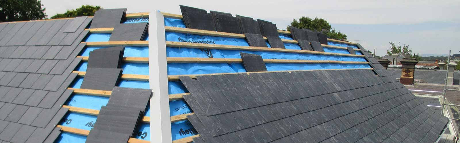 Slate roofing on new construction project